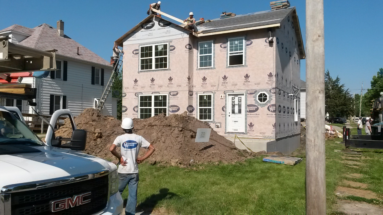 """Tradesmen complete """"drying-in"""" of the roof and gable ends."""